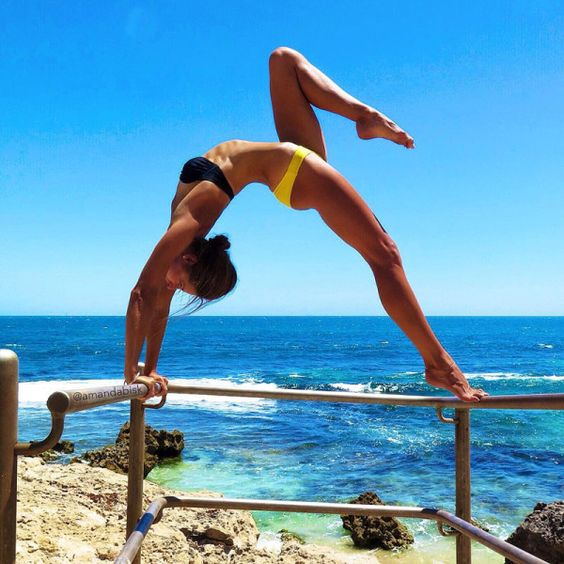 - This 22-year-old Australian athlete is a no-brainer. Her selfies are always packed with gorgeous sunsets and gravity-defying leaps and twists. The former pole vault champion taught herself yoga to combat chronic fatigue syndrome—and now inspires others to do the same by sweating every day against a beautiful backdrop. Plus, her active wardrobe is on point.@amandabisk