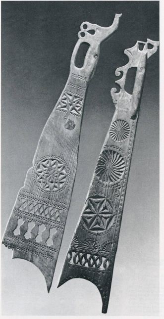 Flax sword with symbols.  Translate to find meaning of symbols