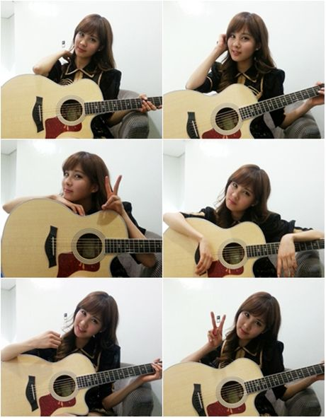 Seohyun shares a message for her fans and takes a photo with her guitar