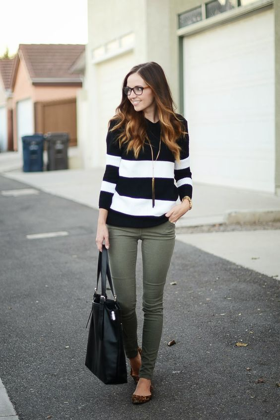 Business casual work outfit black striped sweater, olive skinnies. Id wear