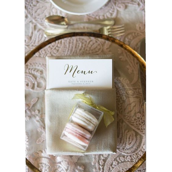 Finishing up this stunner right now. Beyond elegant from the incredible linens from @latavolalinen to custom monogrammed macaroons to the lovely menu. An incredible collaboration! @ilanaashley @sweetnsaucyshop @calligkatrina @belairbayclub @lapetitegardenia. @katemc93. More very soon! #wedding #losangeleswedding #santabarbarawedding #belairbayclubevents @belairbayclubevents #placesetting #elegant #macaroons #details #lovely #classic