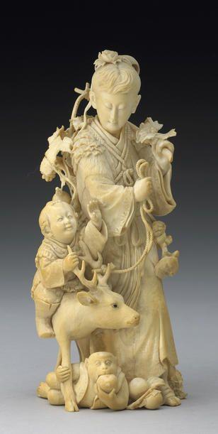 An ivory okimono of Yama Uba and Kintaro 19th Century