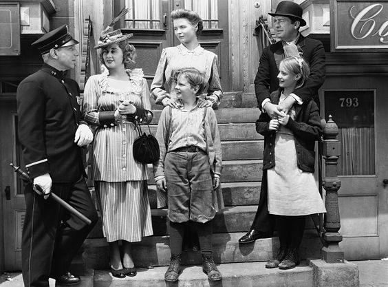Lloyd Nolan as Officer McShane, Joan Blondell Aunt Sissy Nolan, Dorothy McGuire as Katie Nolan, Ted Donaldson as Neeley Nolan, James Dunn as Johnny Nolan, and Peggy Ann Garner as Francie Nolan in the 1945 film A Tree Grows in Brooklyn.
