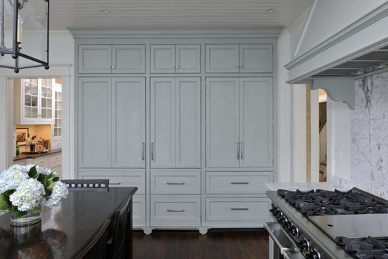 Amy Zantziger's #farmhouse kitchen.  When the refrigerator and the cookbook cabinet doors are closed, the room appears elegant and uncluttered.