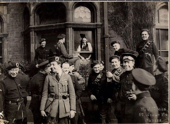 Black and Tan Auxiliaries joking outside of their recently bombed quarters in Dublin, 1920.