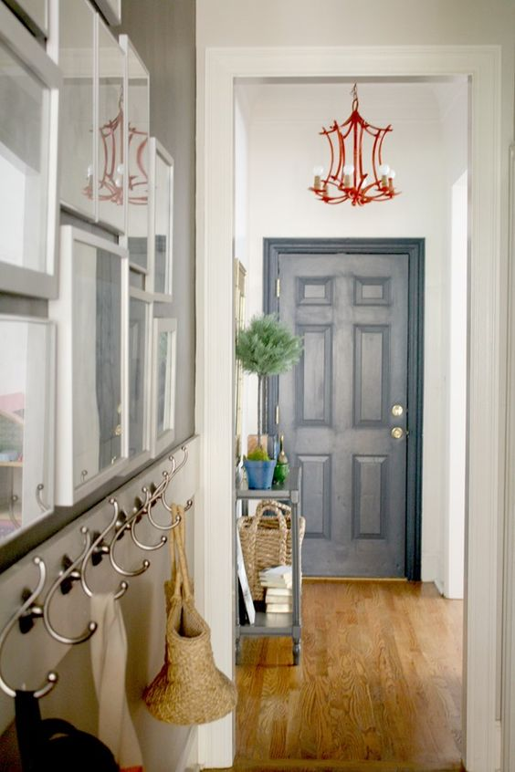 Decorating a small entryway navy door orange bamboo for Small entry door