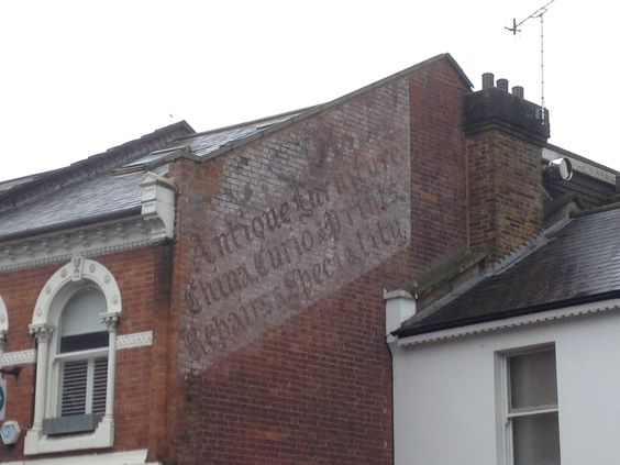 Antiques ghost sign to be found in Dorking, Surrey, UK - taken Sunday 15th March 2015