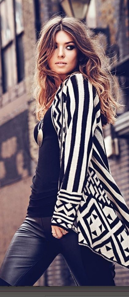 Black and white aztec cardigan. Leather pants.