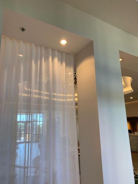 This Spa Added Floor To Ceiling Sheer Curtains To Soften The Look
