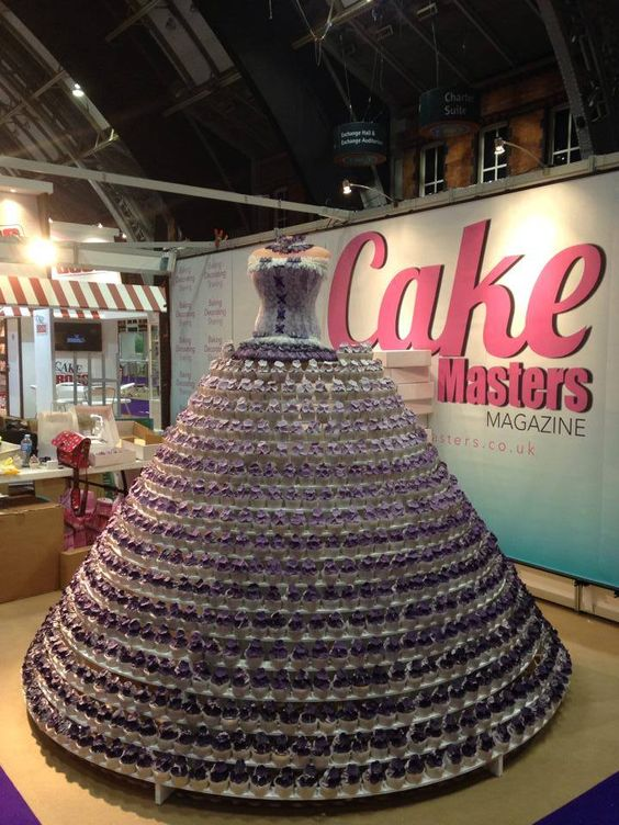 The Cupcake Dress! 800 cupcakes and 5000 purple sugarpaste flowers made in a ombre effect with Purple ProGel. Bodice made of cake lace!