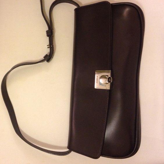 """Vintage Furla Posh vintage brown Furla shoulder bag. Adjustable strap. Features one inside pocket. 11.5"""" wide. 6"""" tall. Cool locking mechanism at the front. No dust bag. Furla Bags"""