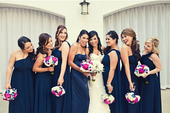 Navy dress with fuschia accent bouquets.