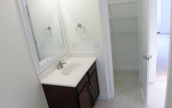 The guest bath offers plenty of space and a walk in linen closet for storage.  Also, another storage closet is located off of this room