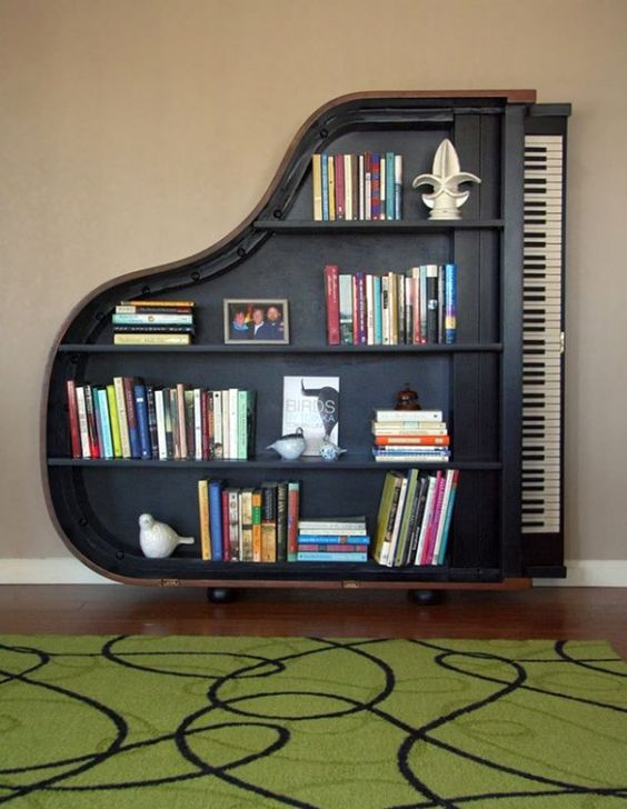 13 bookshelf decorating ideas, including this bookcase makes use of an old piano. How grand!: