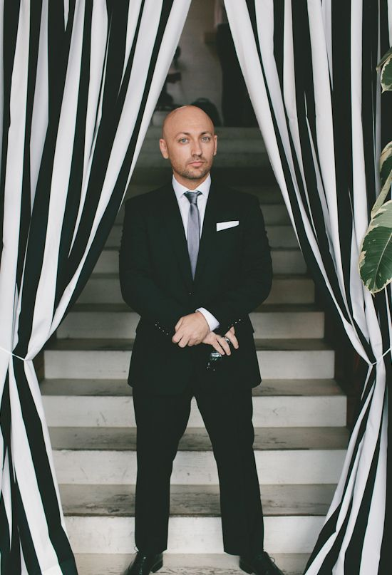 black and white striped curtain and black suit