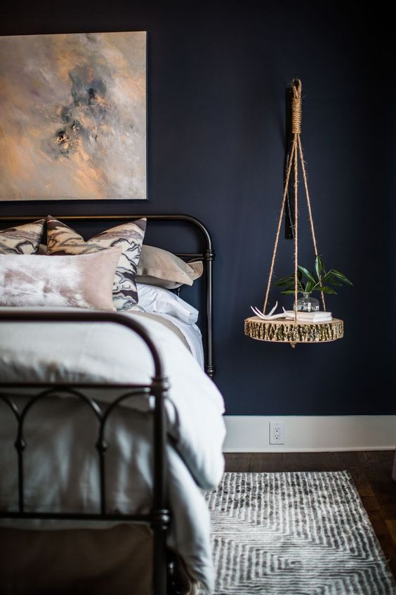 A Moody Bedroom With A Hanging Bedside Table Of A Raw Edge Wood Slice And Twine For A Living Room Table Sets Purple Accent Chair Living Room Living Room Table