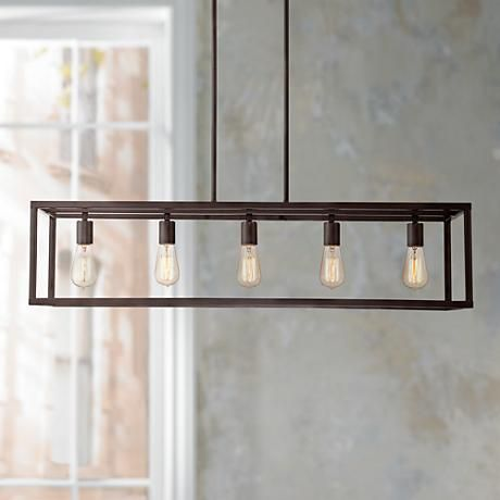 The unadorned style of this steel framed island chandelier adds the perfect vintage touch.