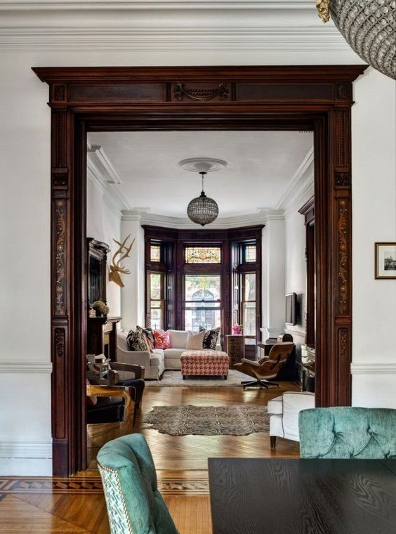 Beautiful wood work on doors and windows. Victorian home with a bohemian decor Good idea for between living room and office...