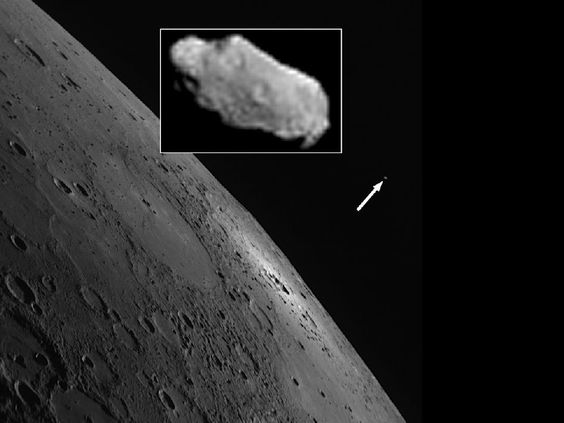 """""""Mercury's moon."""" March 31, 2012. It's a small bright spot in the discovery image, taken yesterday by the MESSENGER wide angle camera. The moon is about 70 m (230 ft) in diameter, orbiting Mercury at a mean distance of 14,300 km (8,890 miles). The name Caduceus, after the staff carried by the Roman god Mercury, is proposed to the IAU. (Credit: NASA) APRIL FOOL! Mona Evans, """"Astronomy April Fools"""" http://www.bellaonline.com/articles/art183019.asp"""