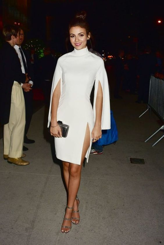 Splurge: Victoria Justice's Tony Awards After Party House of CB White Kristiana Crepe Cape Sleeve Dress, Vince Camuto Bayron Sandals, and Adriana Castro Silver Snake Minaudiere