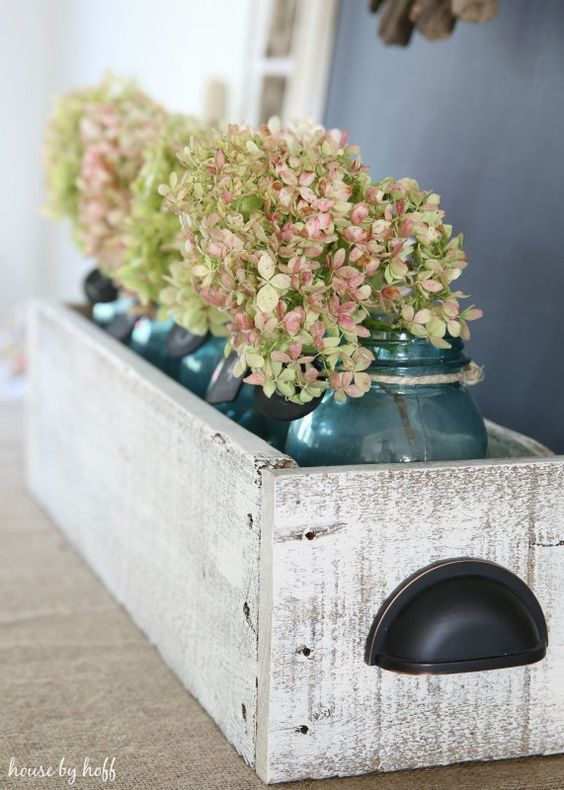rustic box with cup pulls and mason jars & hydrangeas