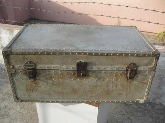 I like the finish on this old metal trunk. Would be a cute solution for additional storage.