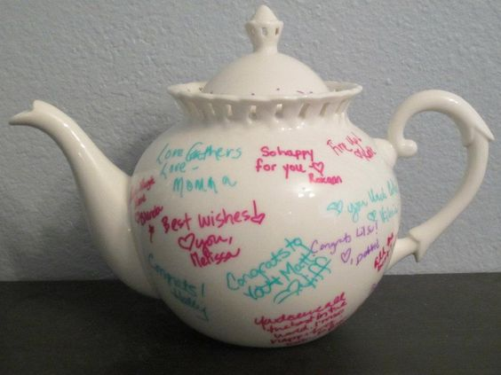 For my tea party themed bridal shower I had everyone sign a tea pot instead of using a guest book.: