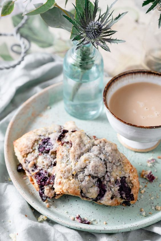 Cherry Scones are delicious sweet scone recipe full of citrus, vanilla, almond, and cherry flavor. Easy breakfast scone recipe! #cherryscones #sconerecipe #sweetscones #twocupsflour