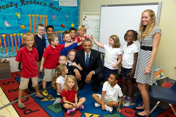 2014: Year in Photos: the President with schoolchildren in Florida just after he'd told them not to make rabbit ears