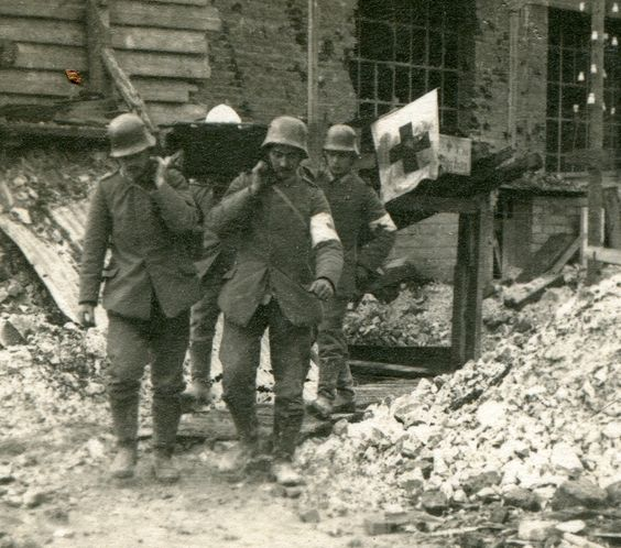 WW1, German medics taking a wounded soldier from a first aid/dressing station…