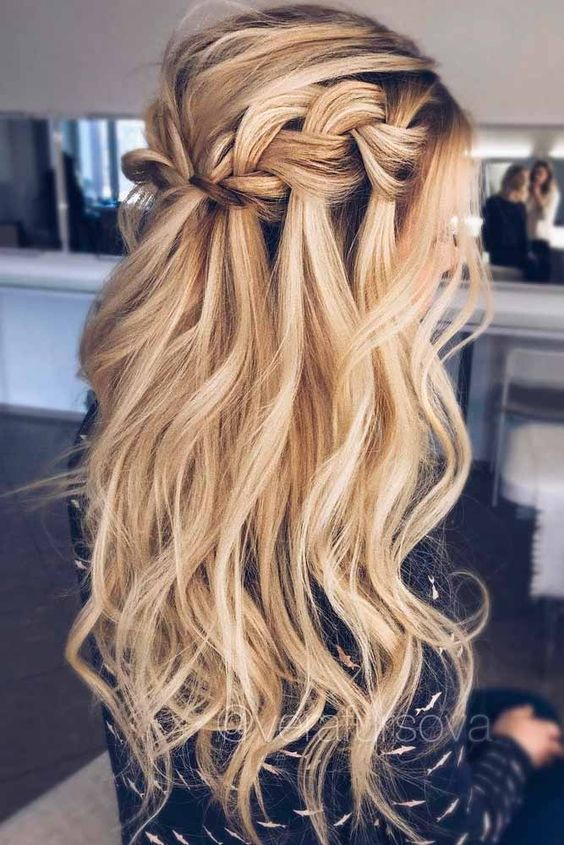 A Long Wavy Half Updo Hairstyle With A Braided Halo And Locks Down For A Boho Feel Hair Styles Long Hair Styles Ball Hairstyles