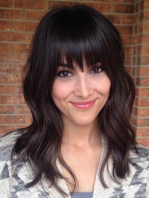 medium layered haircut with straight bangs: