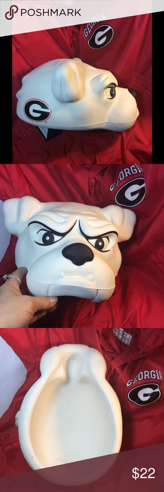 University of Georgia Bulldog Hat Really unusual and such a fun hat for Georgia fans!  Wanna get the TV cameras on you at the game?  Happened to us twice, so be ready!  Other fans will stop you to see it!  Be the life of the gridiron party!  Hat is made of some kind of moulded spongy/soft foam.  You can see mould lines, small crack areas and small bubble/defects when you look closely at the spongy material.  It has always been that way and can't really be seen at a distance.  Can be cleaned…