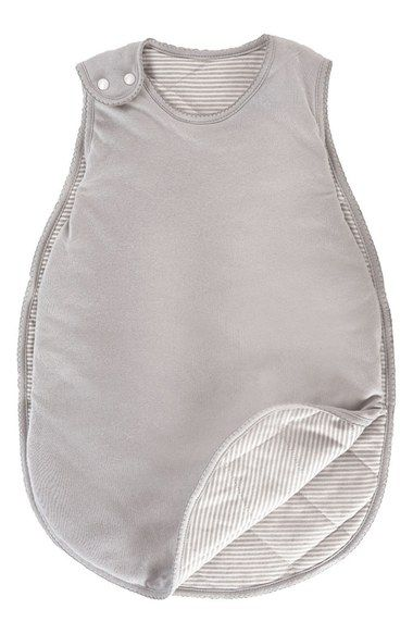A soft, quilted wearable blanket features open sides and a reversible design. Open at the base, it won't restrict little feet and allows for hassle-free midnight diaper changes.