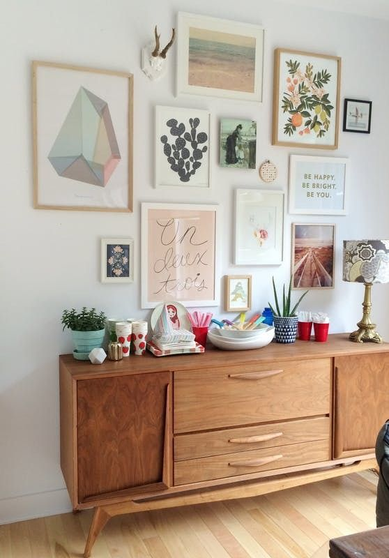 Keep your gallery wall chic by sticking to a cohesive color palette.