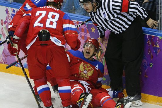 Russian Men's Hockey Team 'Unstable' in First Olympic Win   NHL stars Ovechkin and Malkin scored early to please home fans in Sochi, but tiny Slovenia stuck around longer than expected.