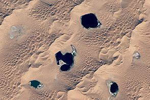 Megadunes and desert lakes in China: NASA Earth Observatory