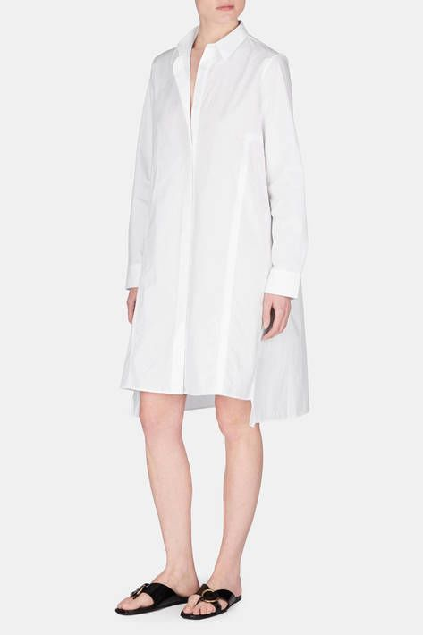 Minimalist and Scandinavian-cool, Acne is a master of the shirtdress. For spring 2016, creative director Jonny Johansson offers a fresh iteration of this wardrobe staple. This piqué version has the clean lines and crisp feel of a classic, yet its sharp A-line silhouette, forward-set side seams, and high-low hem make it new and modern. Buttoned to the neck, this piece is pure in an urbane way, while unbuttoned at the neck, it is light and carefree.