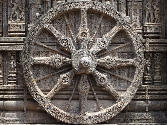 Carved wheel of the Sun Chariot of Surya ( Sun God) in the Sun Temple Konark, India.  picture wikimediacommons/Kiranraj120