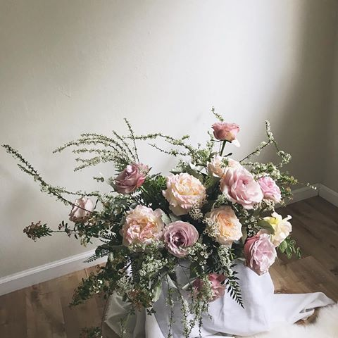 Dusty Blush And Soft Mauve Floral Centerpiece Of Garden Roses Helleborus And Spirea From A Spring Wedding Photoshoot In S Mauve Wedding Floral Spring Wedding