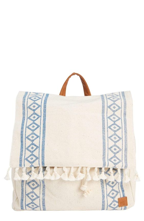 Geo-patterned burlap, tassel trim and faux-leather accents create a distinctly boho vibe on this chic backpack.