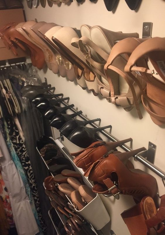 Organized shoe storage for (an offensive amount of) shoes without using a SINGLE INCH of precious floor space.: