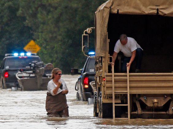 Thousands rescued from waist-deep Louisiana flood waters which the Governor called unprecedented and historic