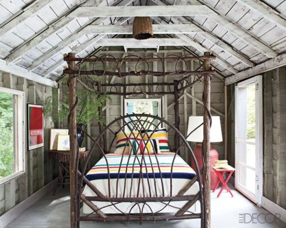 cottage style--twig bed and Hudson Bay blankets