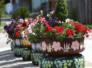 DIY: Recycled Tire Garden Planters. This would be a fun project for the kids in our rain garden :)  I am getting so excited!