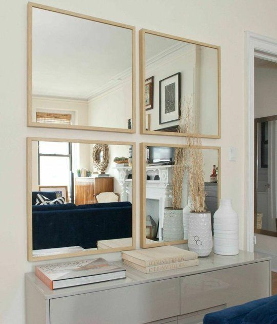 Meredith's Fresh Start in the City — House Call. A little too white, but love the symmetrical grouped mirrors and how light it all feels. Plus a navy couch - yum.