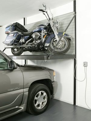 Garage Storage Solutions - Mower Lift, Popular Mechanics... this would be awesome when we build our big house!
