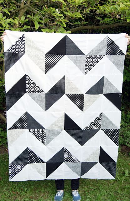 White, black and gray checron quilt make from HST half square triangles. love geometric quilts. so modern.