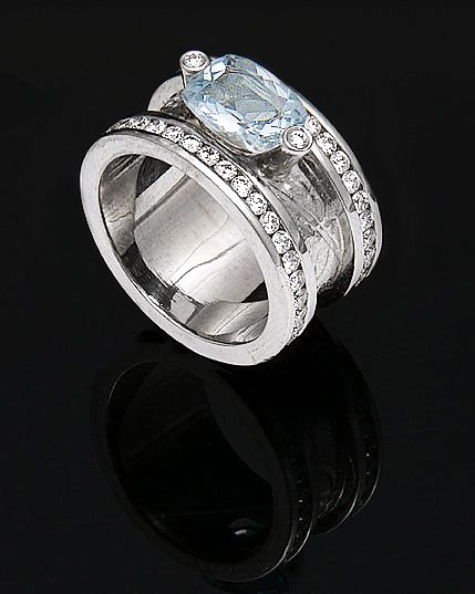 Another Frida Fine Jewellery piece with diamonds and an aquamarine.
