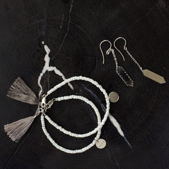 Making there way to one of our lovely customers: white heishi shell beaded bracelet with grey tassel and hex dangle earrings.  lucajewelry geometricjewelry hexagon beadedbracelet friendshipbracelet minimaljewelry jewelry bracelet summerjewels #silverjewelry #petrifiedwood